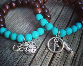 Yogi inspired brown wood bead and turquoise mala meditation bracelet with beer yoga om charms