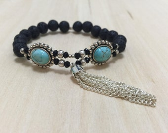 Black Lava Beaded Bracelet with Circular Silver and Turquoise Bead and Silver Tassel