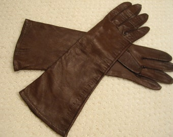 vintage dark brown genuine  leather gloves . . ladies size S . . mid-arm length . . gently worn . . . . nylon lined