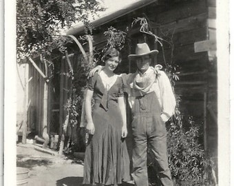 Old Photo Cowboy and Woman Man wearing Overalls Kerchief Hat Woman wearing Dress 1930s Photograph snapshot vintage