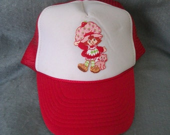 Strawberry Shortcake-Trucker Cap ,  impress , success . cute dressed. Fits all. see photos -Nice.
