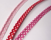 2mm polka dot spot print flanged insertion piping cord on a 9mm band, baby pastel pink fuschia and red with white spot - sold by the metre
