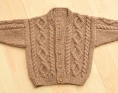 babies hand knitted aran style cardigan