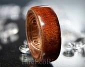 Wood wedding band rings Mahogany wood with old Irish penny coin.