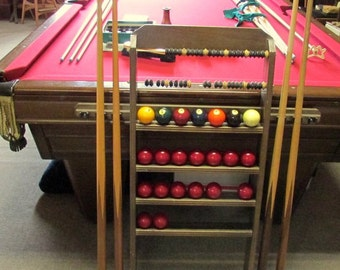 Vintage Heritage 9 ft. pool table by Brunswick. Lots of extras, see description for details.PRICE REDUCTION 9/19/15