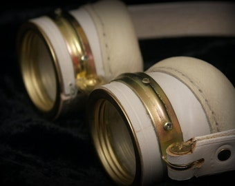 Steampunk goggles in white leather and brass.