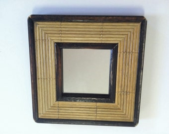 Framed reed-looking accent mirror