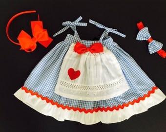 Dorothy Wizard of Oz Big Bow Apron Ruffle Dress (Newborn-4T) Dorothy Blue Gingham Dress,  Wizard of Oz Dorothy Dress, Big Bow, Apron Dress