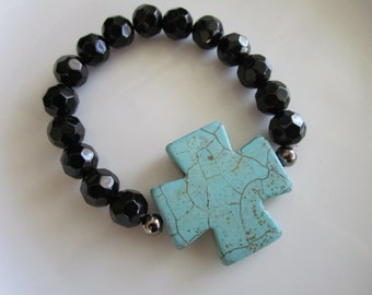 Semi precious stone turquoise side cross, black multifaceted beaded elastic bracelet with turquoise howlite side cross, turquoise side cross