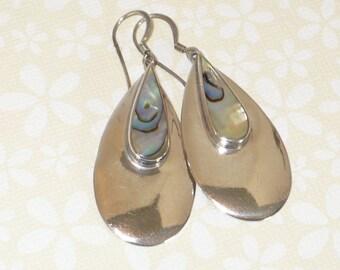 Sterling silver and abalone shell teardrop earrings.