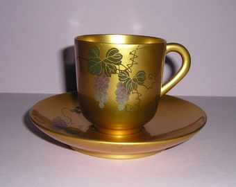 Rare hand painted gold laquered coffee cup and saucer