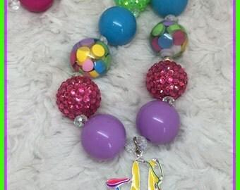 I love my bike chunky necklace: purple, pink, yellow, blue, lime green, rainbow.