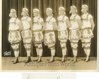 Performers acrobats in fantastic costumes antique photo