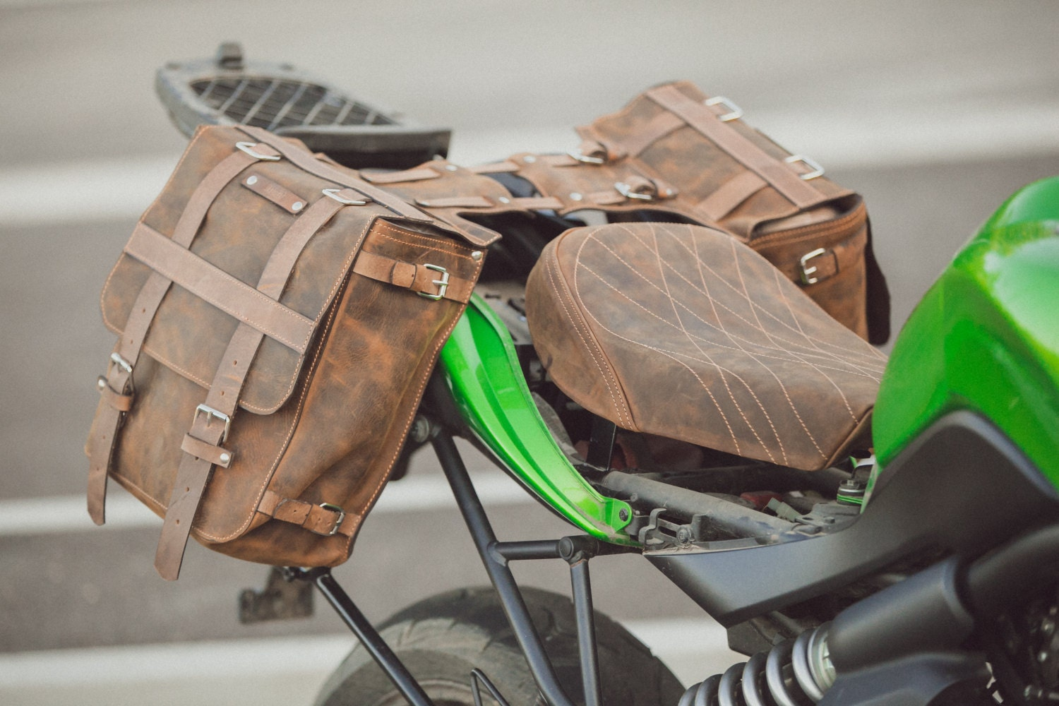 Motorcycle saddle bag and a leather dressed seat for Motor cycle saddle bags