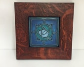 4x4 Motawi Rosie O'Grady - Turquoise Art Tile Framed in a Family Woodworks Signature Red Oak Park