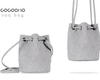Saq bag light grey texture bucket bag crossbody shoulder pouch sac purse drawstring vegan faux leather pockets zipper simple everyday city