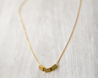 Gold necklace with triangles