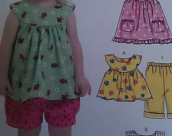 Toddlers top, dresses, shorts and pants pattern.