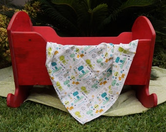 Hand made baby blanket with robot motif.