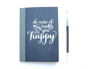 Notebook, black white, with quote Happy