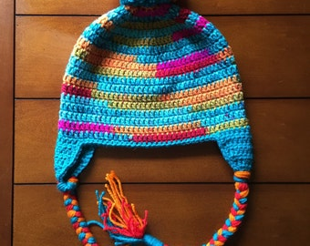 Crochet winter hat with ear flaps and braids