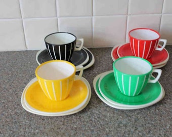 Plastic Welware cup saucer plates x 4