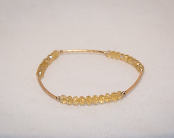 Yellow Elastic Beaded Bracelet with a hint of Gold
