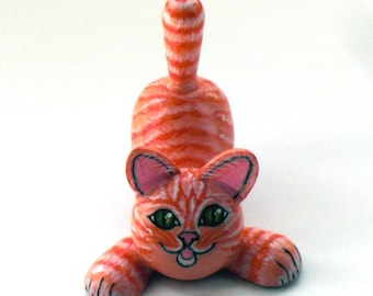 "Wooden toy ""ginger tabby cat""."