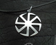 FREE SHIPPING Kolovrat pendant - Slavic symbol of the sun