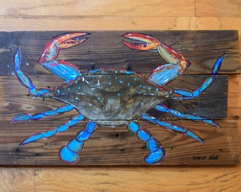 Blue claw crab on reclaimed wood