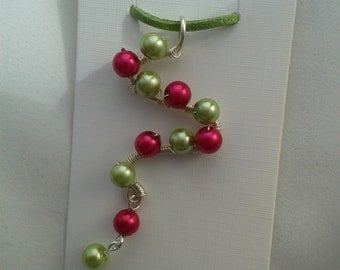 Green and Red Faux Pearl pendant on a green suede cord