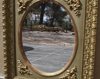 An Antique French Framed Oval Mirror