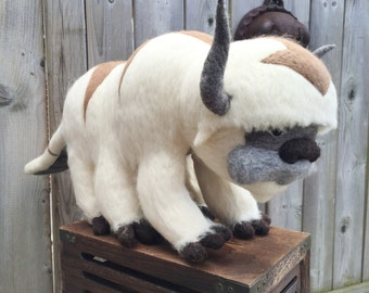 "Appa, a flying bison is a 100% handmade needle felted character. measures 24"" from nose to tail and is 11"" high."