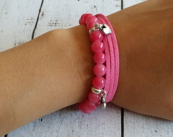 Bracelet with glass beads and charms