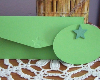 Envelope with the green card, embossed with star