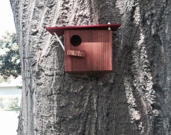 Hanging birdhouse made of solid wood