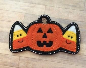 Smiling candy corn and pumpkin felt headband slider