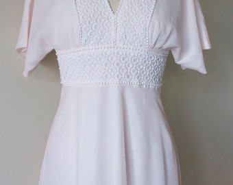 Blush pink bohemian floaty 1970's wedding dress with v neck and lace trim