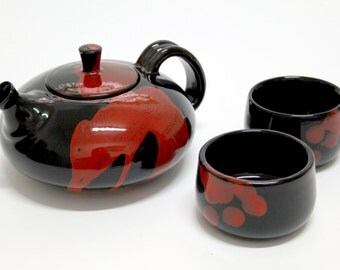 Glazed earthenware teapot, with 4 cups.