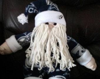 Darling handmade plush Santa wearing Dallas Cowboys pajamas.