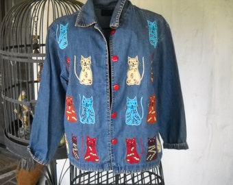Petite Small, but runs larger denim jacket with appliqued cats! All cotton, super soft, if you love cats you will love this jacket.