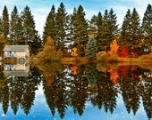 Landscape with fall colors reflecting in the lake.