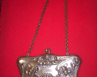 Antique intricately detailed Silver  coin purse handbag with original mirror. Over 100 years old clasp closure floral design.