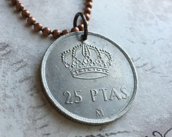 SPANISH 25 PTSAS coin pendent on a 24 inch ball chain necklace.