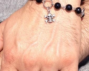 SKULL BRACELET: base metal bracelet with glass beads and metal skull charm.