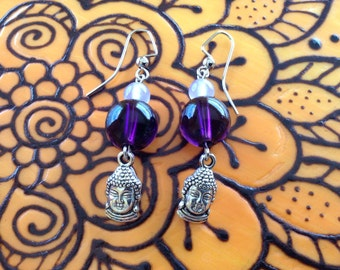 You cannot travel the path until...Beautiful Buddha head earrings with dark and light purple glass beads.
