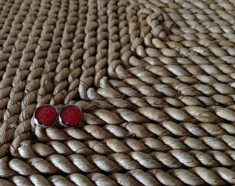 Mini silver Cinna-Bomb explosion Rudy red glitter 10mm silver stud earrings.