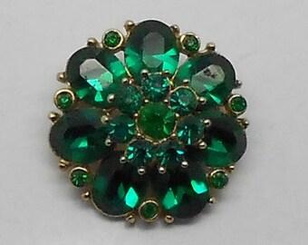 Vintage green rhinestone open back, foil covered flower brooch