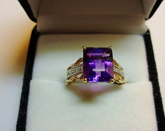 Natural Amethyst with Diamonds in a Gold Ring.