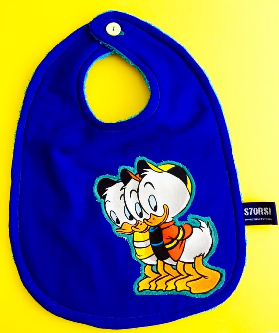Huey, Dewey and Louie, extra-large baby bib. Double sided. Ideal for the first bites and baby-led weaning.